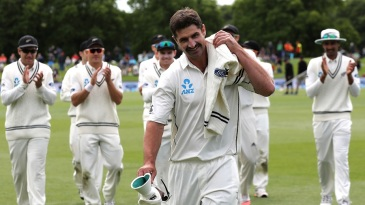 Debutant Colin de Grandhomme is applauded by team-mates as he leads them off the ground