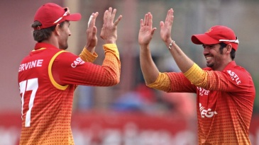 Graeme Cremer celebrates the tie with Craig Ervine