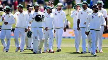 The Pakistan players walk off the field
