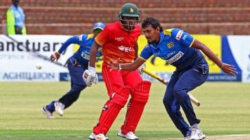 Suranga Lakmal prepares to collect the ball