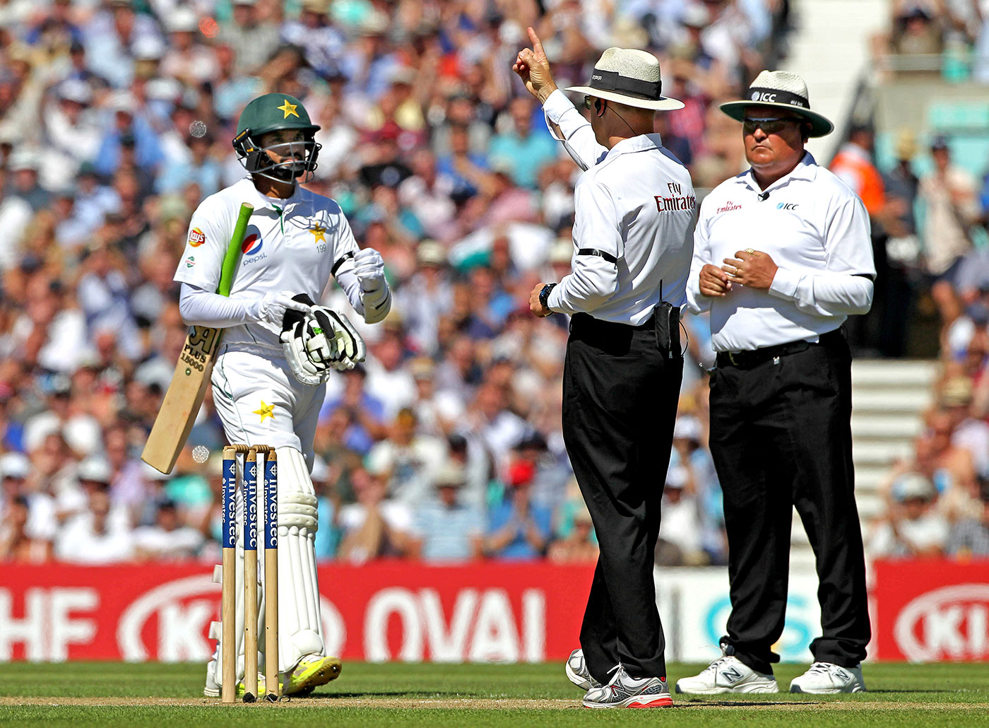 Rave reviews: Umpire Bruce Oxenford (raising finger) has had the lowest proportion of referred decisions overturned