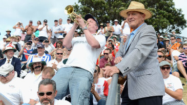 Barmy Army trumpeter Billy Cooper entertains spectators and Geoff Boycott