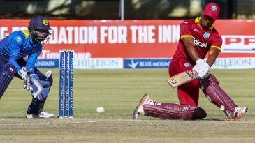 Evin Lewis sweeps during his maiden ODI ton