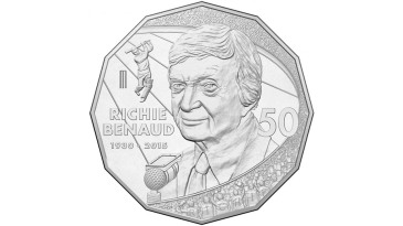 The new limited-edition Richie Benaud 50-cent coin which was used at the toss