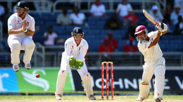 Ian Bell jumps to avoid a shot from Ramnaresh Sarwan