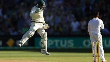 Usman Khawaja leaps in celebration after bringing up his century