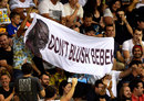 Spectators hold up a banner referring to Chris Gayle's comments to a female sports presenter, Brisbane Heat v Adelaide Strikers, BBL 2015-16, Brisbane, January 8, 2016