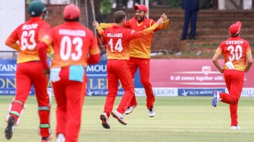 Zimbabwe's players celebrate after taking a wicket