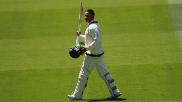 Usman Khawaja acknowledges the applause while walking off for 145