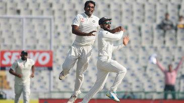 Jayant Yadav celebrates the dismissal of Joe Root