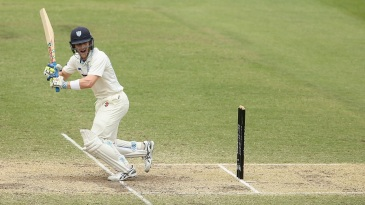 Peter Nevill works the ball to leg