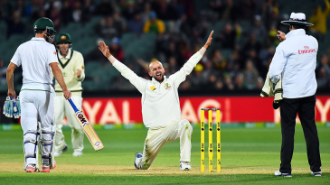 Nathan Lyon is thrilled after trapping Kyle Abbott leg before