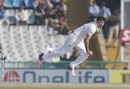 James Anderson mid air on his bowling follow through, India v England, 3rd Test, Mohali, 2nd day, November 27, 2016