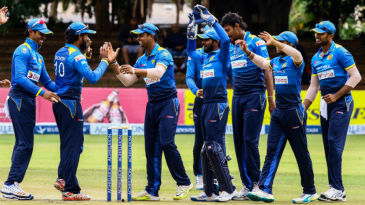 Sri Lankan team huddles together to celebrate a wicket
