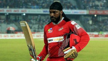 Chris Gayle walks back after clubbing four sixes