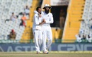 Adil Rashid and Moeen Ali celebrate after dismissing Ravindra Jadeja, India v England, 3rd Test, Mohali, 3rd day, November 28, 2016