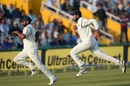 Mohammed Shami and Cheteshwar Pujara engage in a race to pull the ball back, India v England, 3rd Test, Mohali, 3rd day, November 28, 2016
