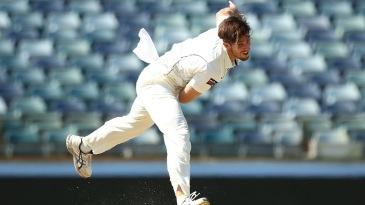 Mitchell Marsh sends down a delivery