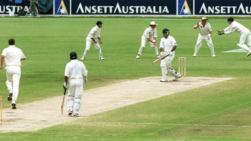 Ijaz Ahmed is caught by Adam Gilchrist off Glenn McGrath