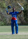 Kamau Leverock raises his bat upon reaching his century off 96 balls, Bermuda v Jersey, ICC World Cricket League Division Four, Los Angeles, November 2, 2016