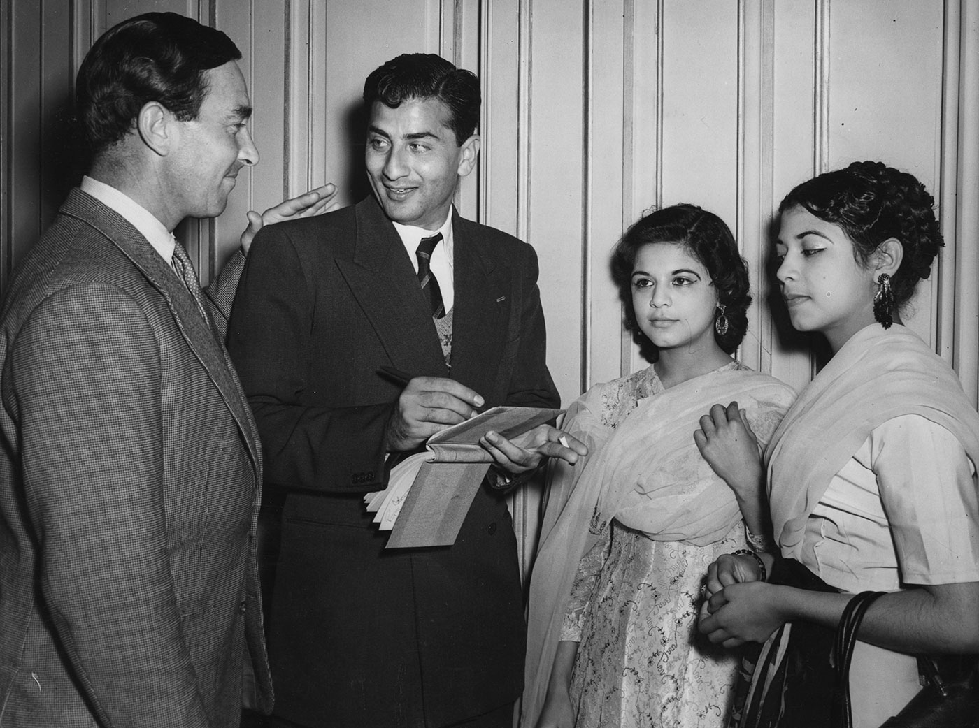 Denis Compton greets Fazal Mahmood, who is signing autographs for fans