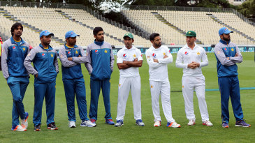 Pakistan players stand around during the presentation ceremony