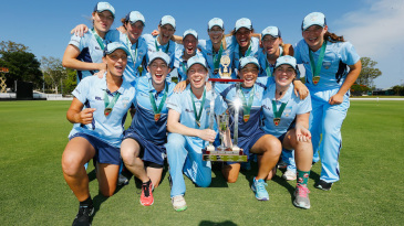 The New South Wales players pose with the trophy