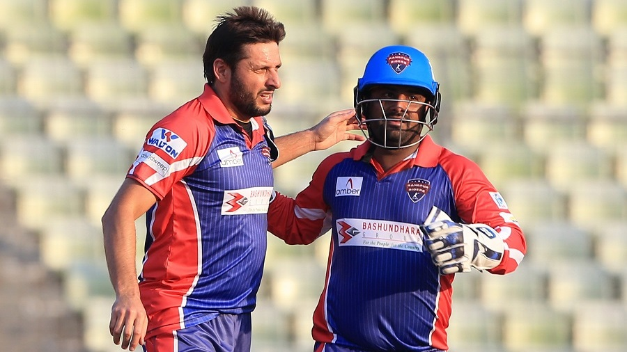 Shahid Afridi celebrates the first of his two wickets with Mohammad Shahzad