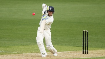 Nic Maddinson drives on his way to his 18th first-class fifty