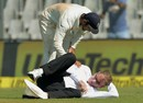 Paul Reiffel was struck on the back of the head by a throw from Bhuvneshwar Kumar, India v England, 4th Test, Mumbai, 1st day, December 8, 2016