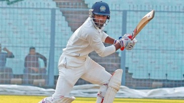 Nitin Saini drives en route to his 13th first-class hundred