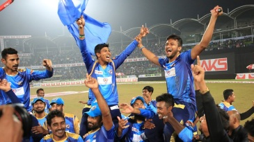 Dhaka Dynamites players celebrate after winning the Bangladesh Premier League
