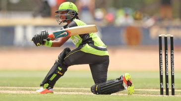 Harmanpreet Kaur plays a sweep during her unbeaten knock