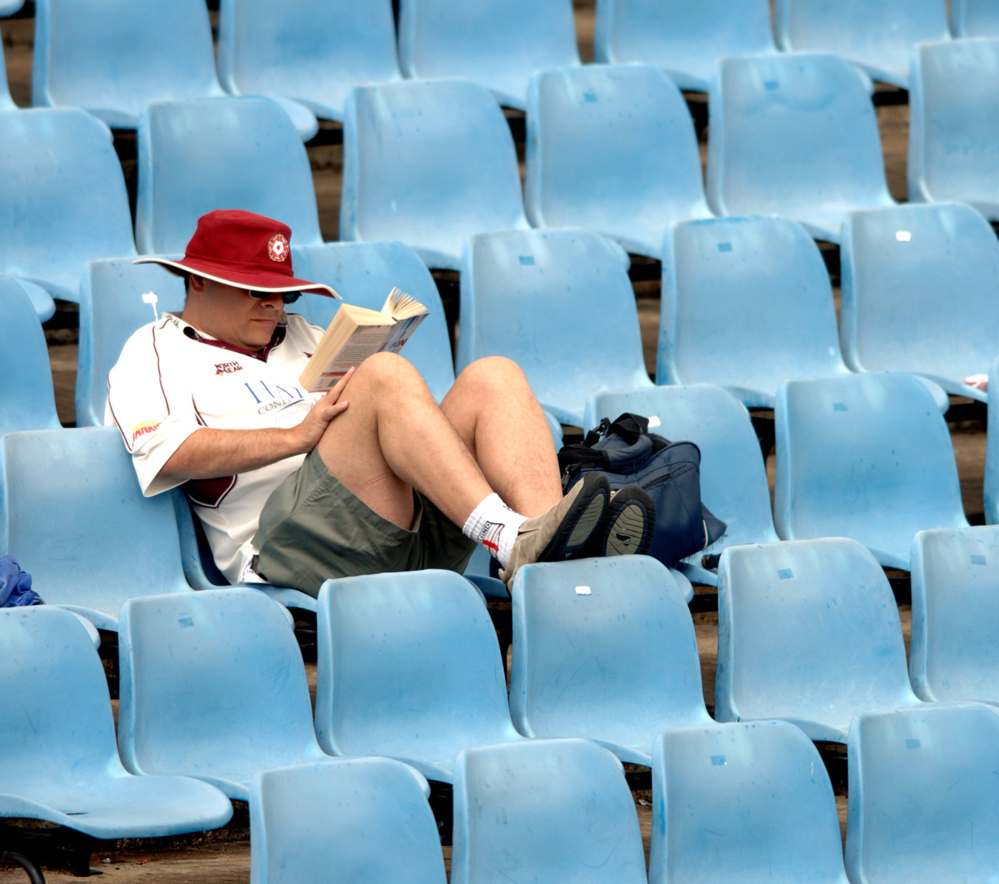 A fan reads in the stands