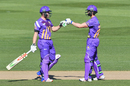 Henry Nicholls and Cameron Fletcher bump fists during their partnership, Canterbury v Wellington, 7th T20 match, Super Smash, Christchurch, Dec 15, 2016