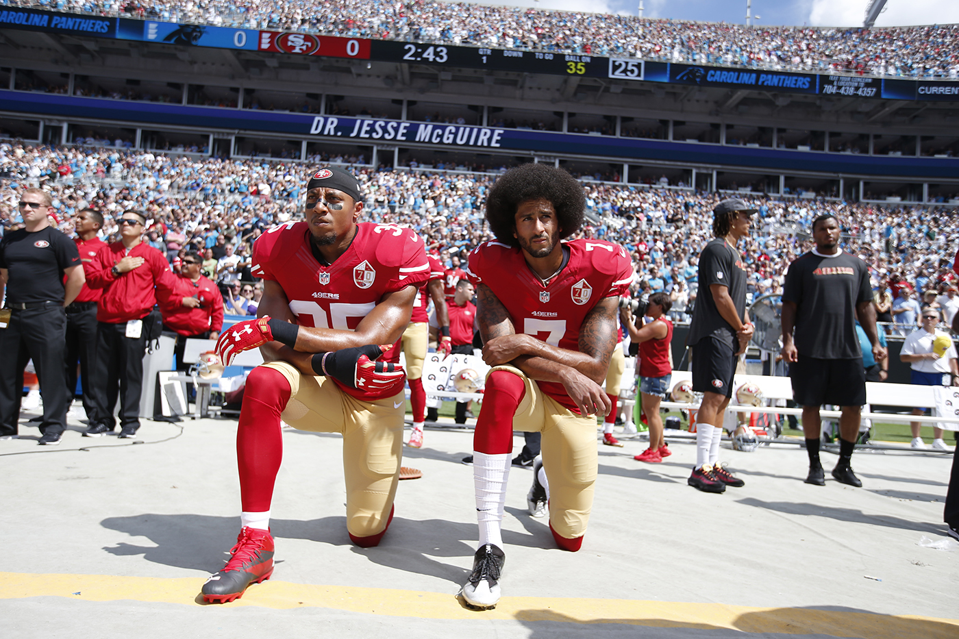 Colin Kaepernick (right) and Eric Reid of the San Francisco 49ers kneel while the national anthem plays before the game against the Carolina Panthers, in September