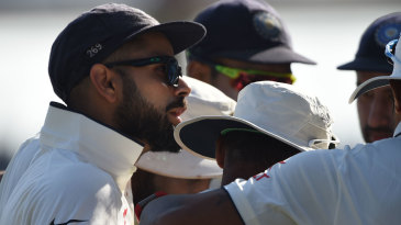 Virat Kohli talks to his team