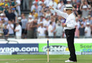 Umpire Tony Hill raises his finger, England v Australia, 3rd Investec Test, Old Trafford, 1st day, August 1, 2013