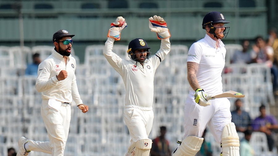 Kohli and Patel celebrate a wicket