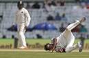 Topsy-turvy: Amit Mishra attempts to field the ball off his own bowling, 5th Test, Chennai, 2nd day, December 17, 2016
