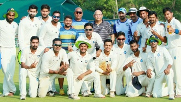 Jharkhand players and staff are all smiles after their win