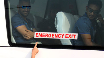 Fans greet MS Dhoni as India's team bus arrives at the stadium