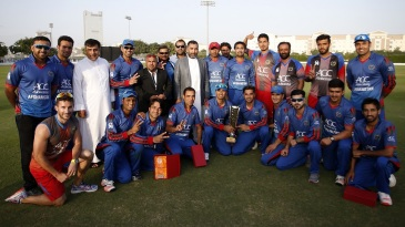 Afghanistan players and staff pose for a picture after their 44-run win