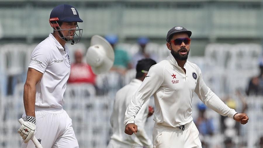 Virat Kohli celebrates as Alastair Cook is caught at leg slip