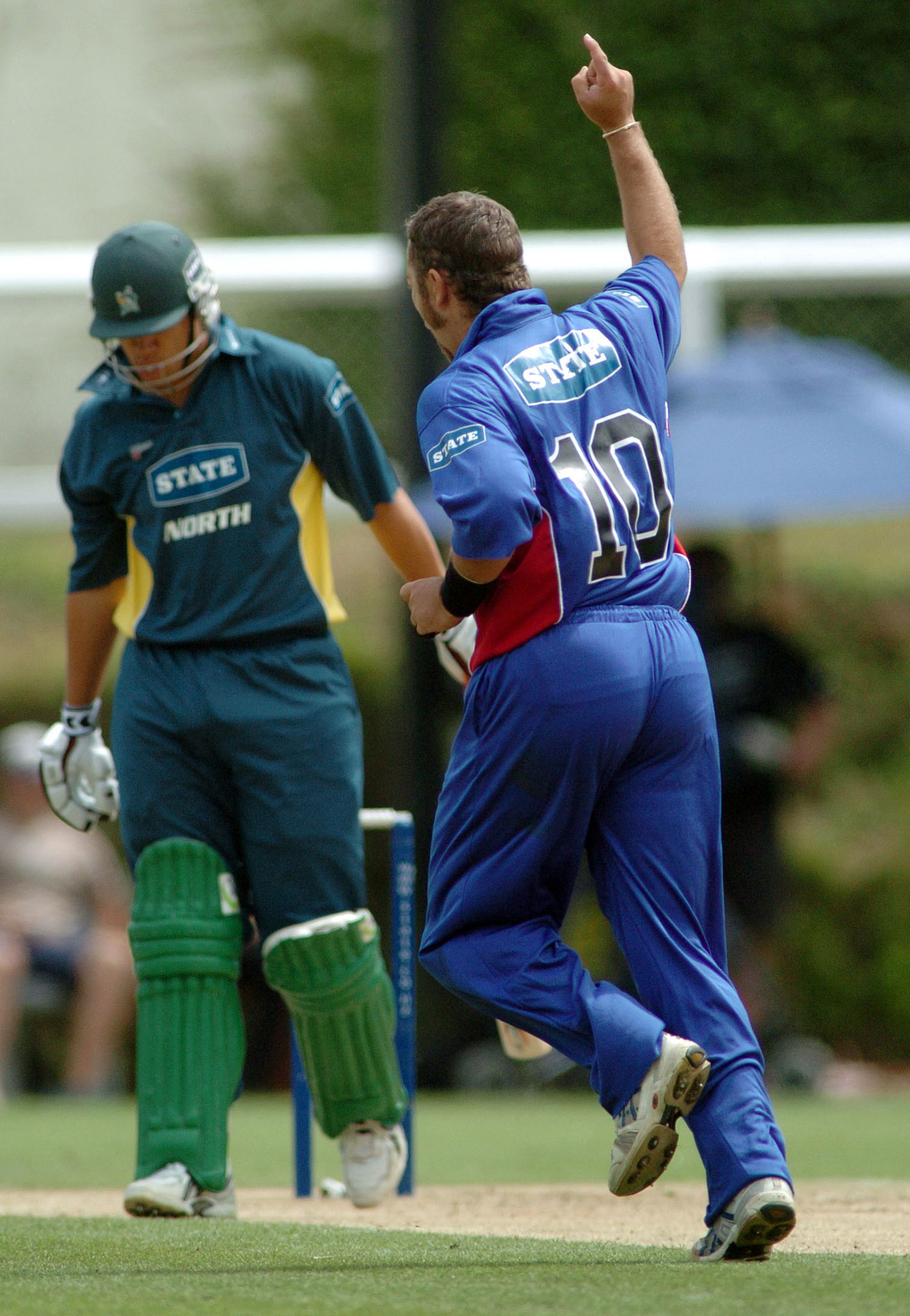 Craig McMillan dismisses Taylor in a North Island v South Island match, 2005