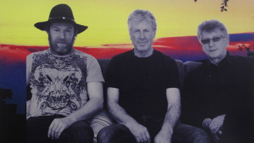 Dean Heatherington, John Wright and Liam Ryan on the cover of their album, <I>Red Skies</I>