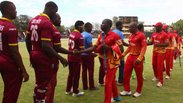 West Indies and Zimbabwe players shake hands after a tie
