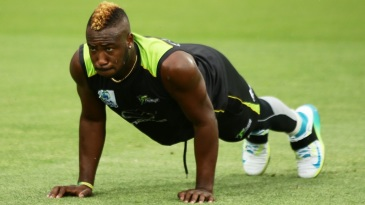 Andre Russell warms up ahead of the match