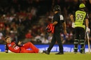 Brad Hogg falls over as he makes an appeal, Melbourne Renegades v Sydney Thunder, Big Bash League 2016-17, Melbourne, December 22, 2016