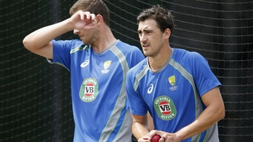 Mitchell Starc bowls during a training session